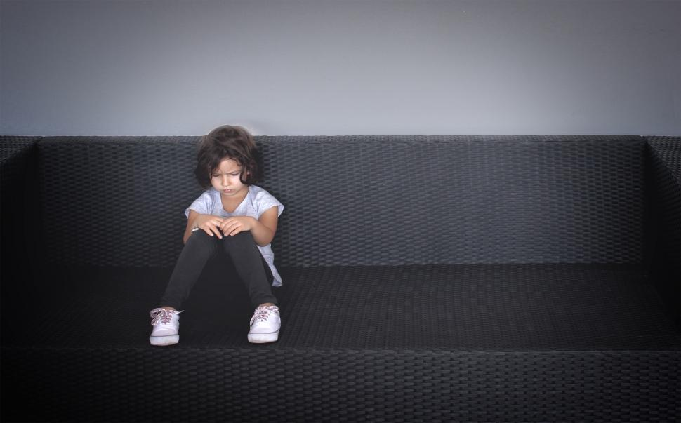 Download Free Stock HD Photo of Sulky young kid on the couch Online
