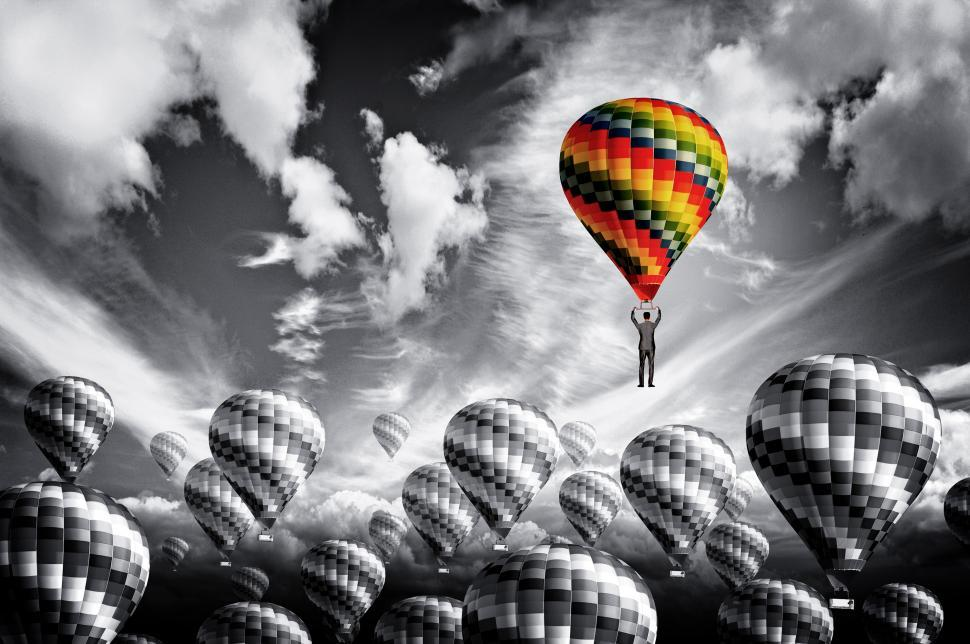 Download Free Stock Photo of Businessman leader rising in a hot air balloon - Leadership conc