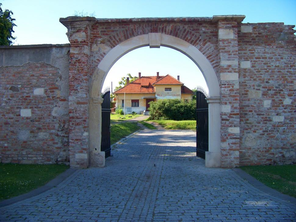 Download Free Stock Photo of House seen through a brick gate