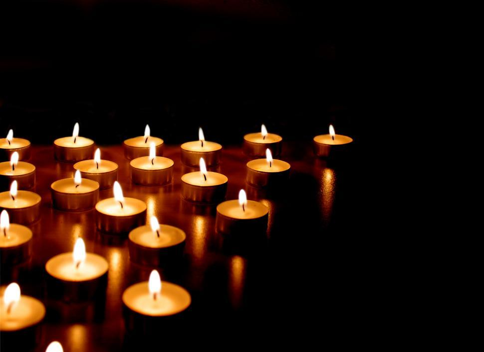 Download Free Stock Photo of Burning candles on black background