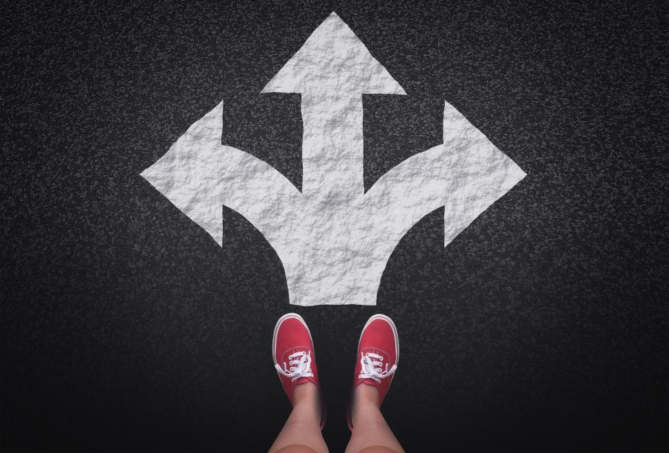 Download Free Stock Photo of At a crossroads - Decisions and choices concept with large arrow