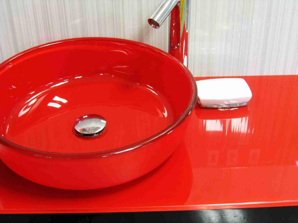Download Free Stock Photo of Red glass bathroom sink