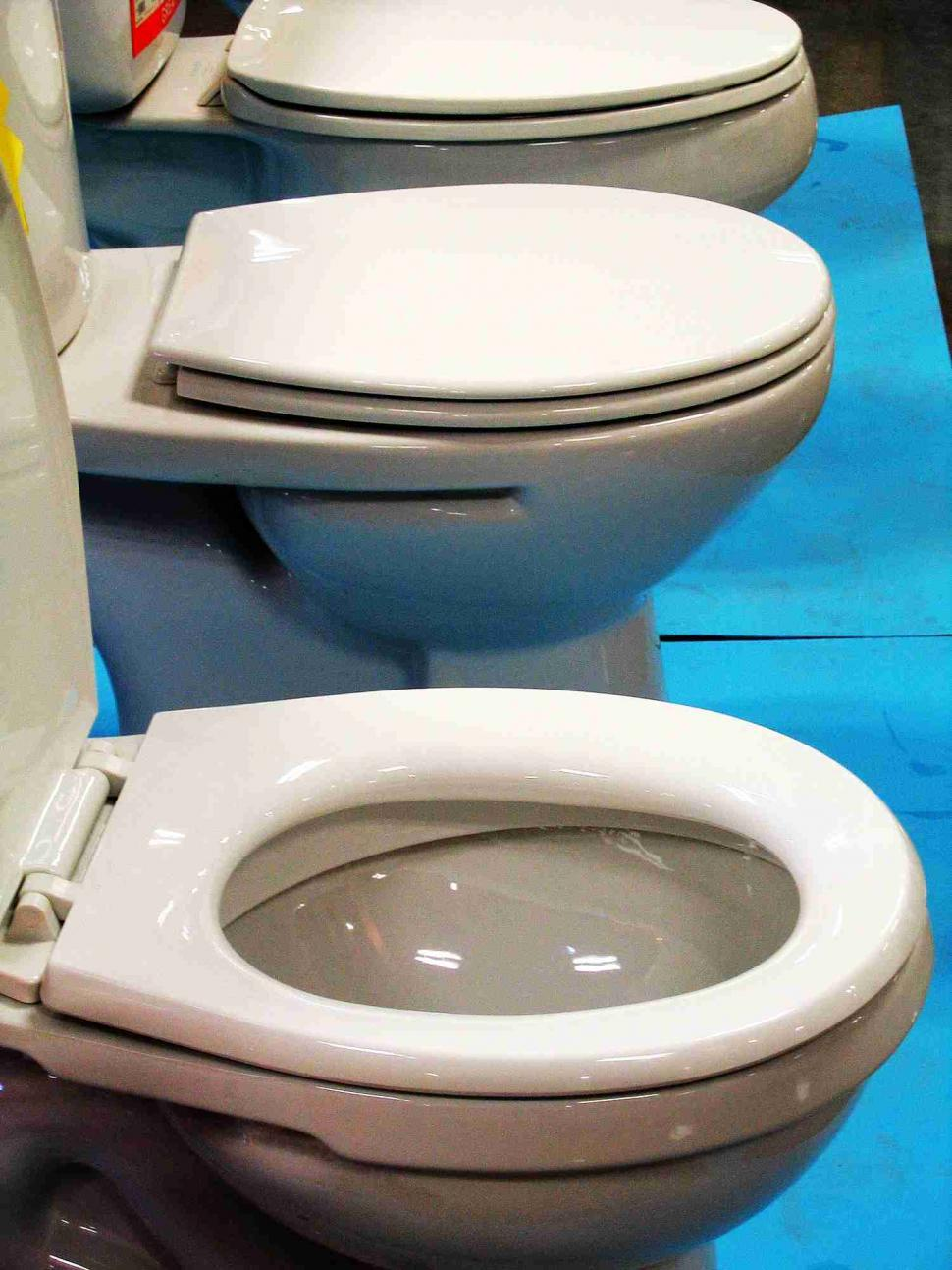 Download Free Stock Photo of Line of toilets