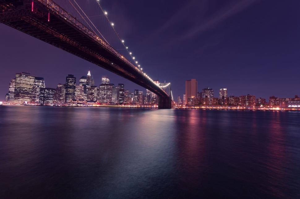 Download Free Stock Photo of manhattan city cityscape bridge architecture skyline urban building river skyscraper pier night waterfront buildings tower downtown support sky travel landmark water modern structure office panorama reflection district town usa business dusk financial device evening