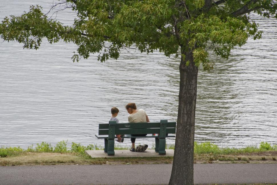 Download Free Stock HD Photo of Mother and Son sit by the river Online