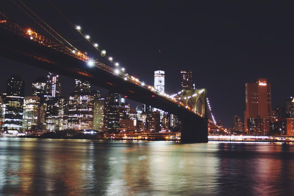 Download Free Stock Photo of bridge waterfront city cityscape skyline night architecture urban pier manhattan river building water sky travel reflection downtown tourism evening boat buildings landmark structure tower harbor skyscraper sunset support dusk town panorama lights