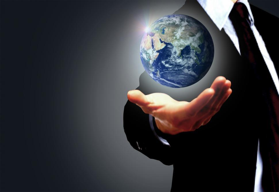 Download Free Stock HD Photo of Hand of a businessman holding Earth globe - Globalization concep Online