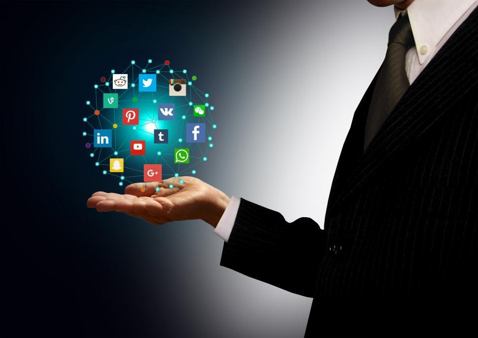 Download Free Stock HD Photo of Businessman holding hologram with social media network icons Online