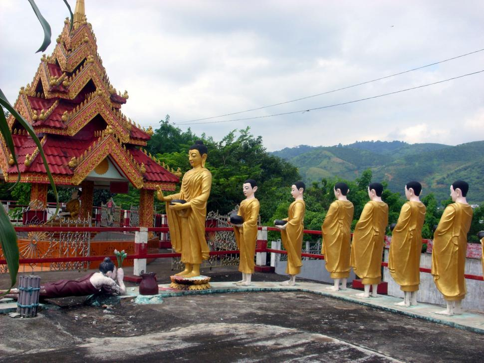 Download Free Stock Photo of Statue of Buddha and followers