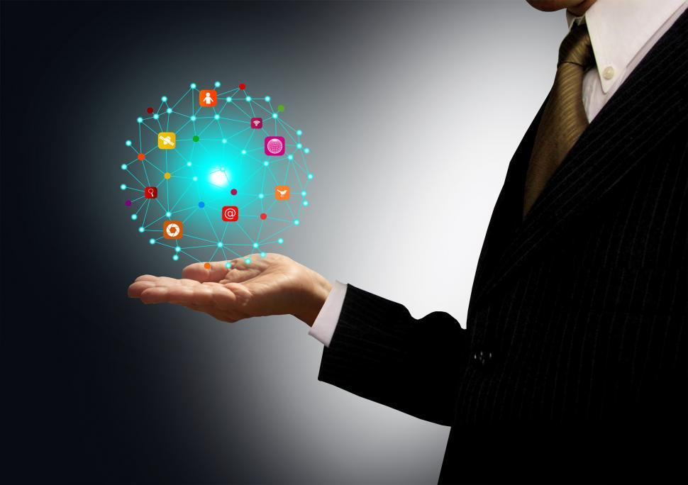 Download Free Stock HD Photo of Businessman holding a ball with information technology icons Online