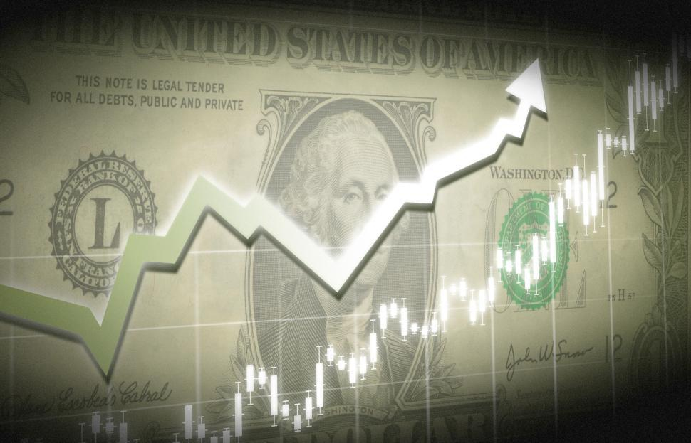 Download Free Stock Photo of Dollar bill with financial graph superimposed