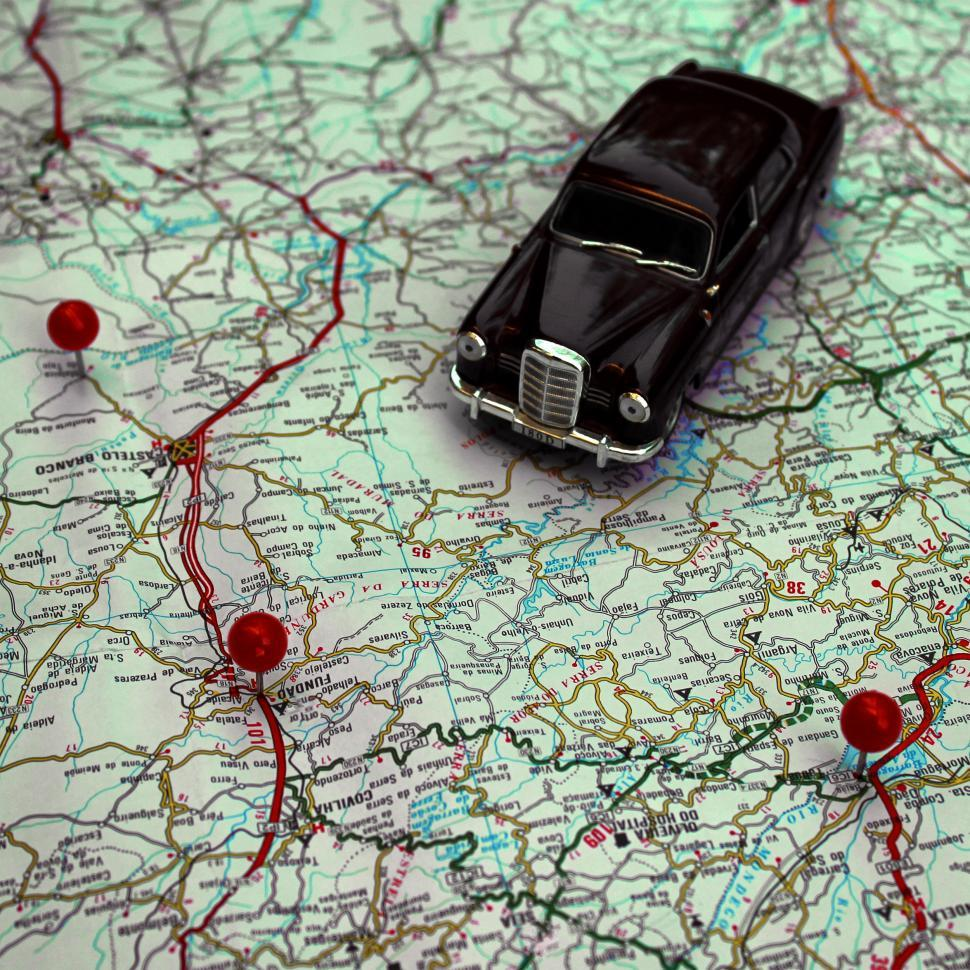 Download Free Stock Photo of Miniature car and pushpins on a map - Travel concept