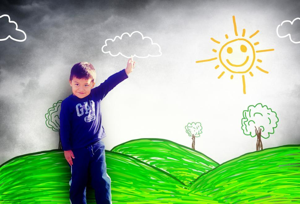 Download Free Stock Photo of Happy child drawing a sunny landscape