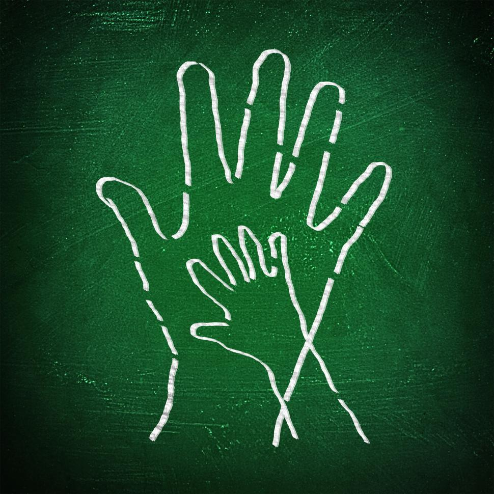 Download Free Stock Photo of Joining hands - A child and an adult join hands on chalkboard
