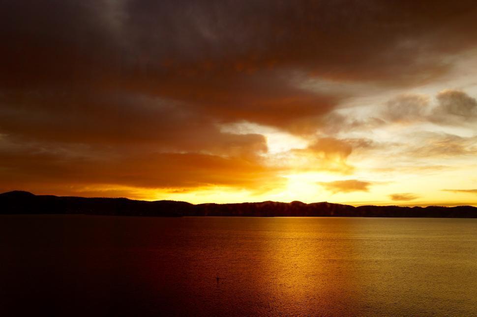 Download Free Stock Photo of  sun,  sunset,  star,  celestial body,  sunrise,  sky,  silhouette,  dusk,  water,  sea,  orange,  dawn,  atmosphere,  evening,  clouds,  ocean,  landscape,  beach,  horizon,  morning,  cloud,  light,  scene