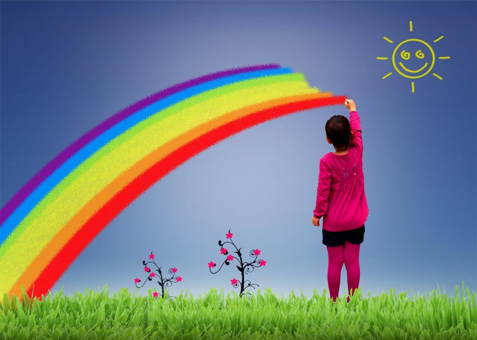 Download Free Stock Photo of Little girl painting a rainbow on the sky