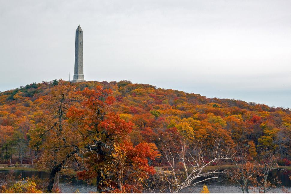 Download Free Stock Photo of High Point Monument From Shore Of Lake Marcia In Autumn
