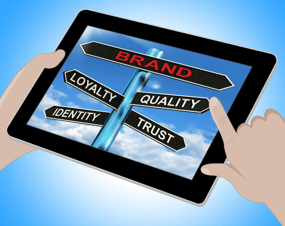 Download Free Stock HD Photo of Brand Tablet Shows Loyalty Identity Quality And Trust Online