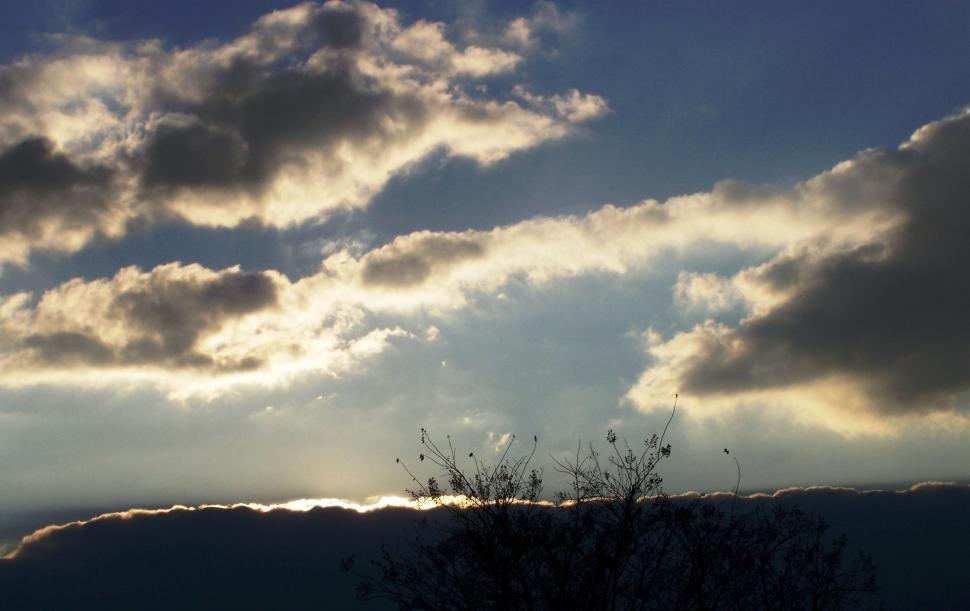 Download Free Stock Photo of Sun Sinking Below Clouds