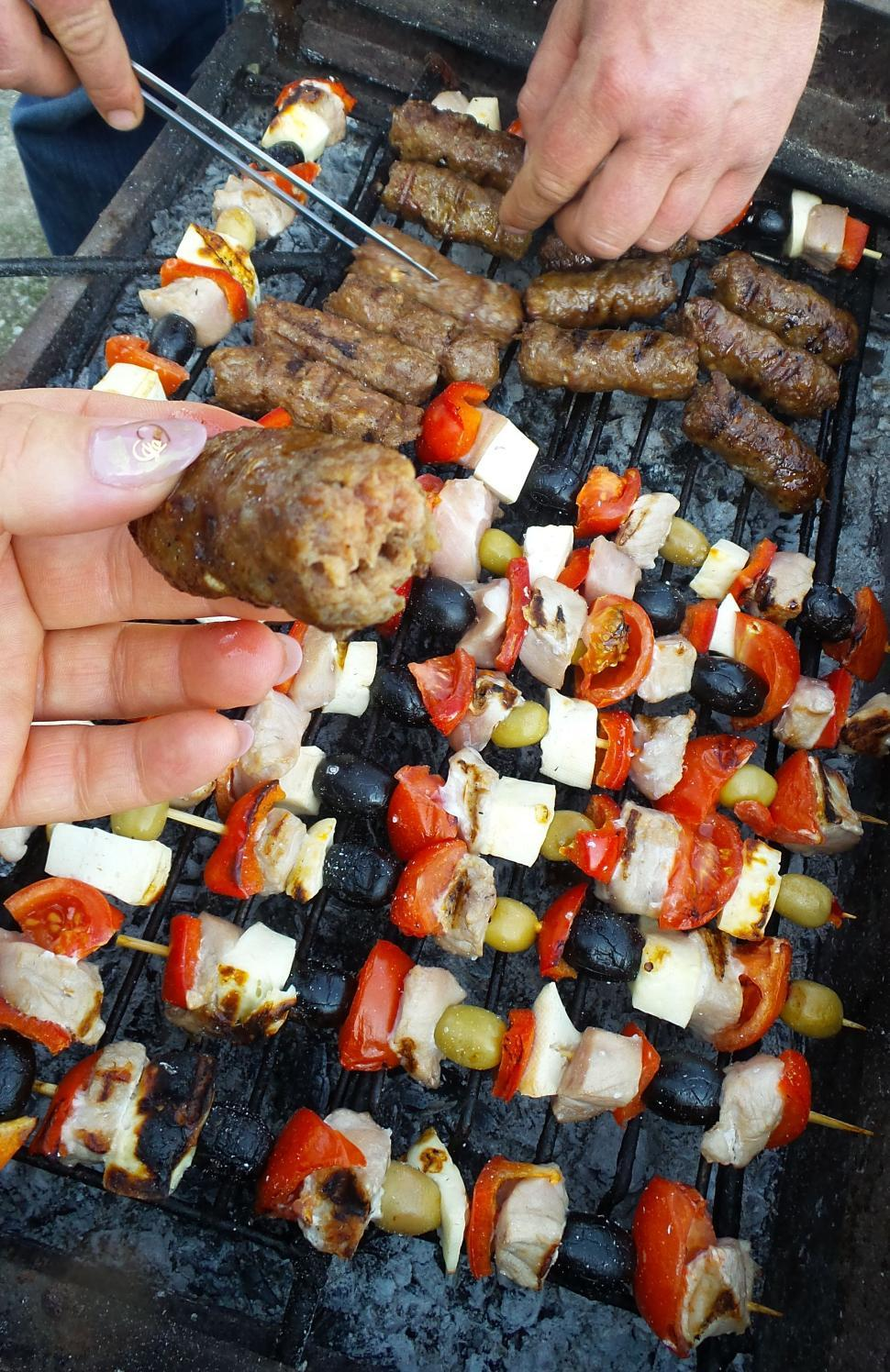 Download Free Stock Photo of Minced meat rolls and chicken skewers on the grill