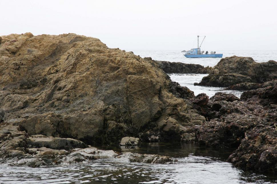 Download Free Stock HD Photo of Boat beyond the rocks Online