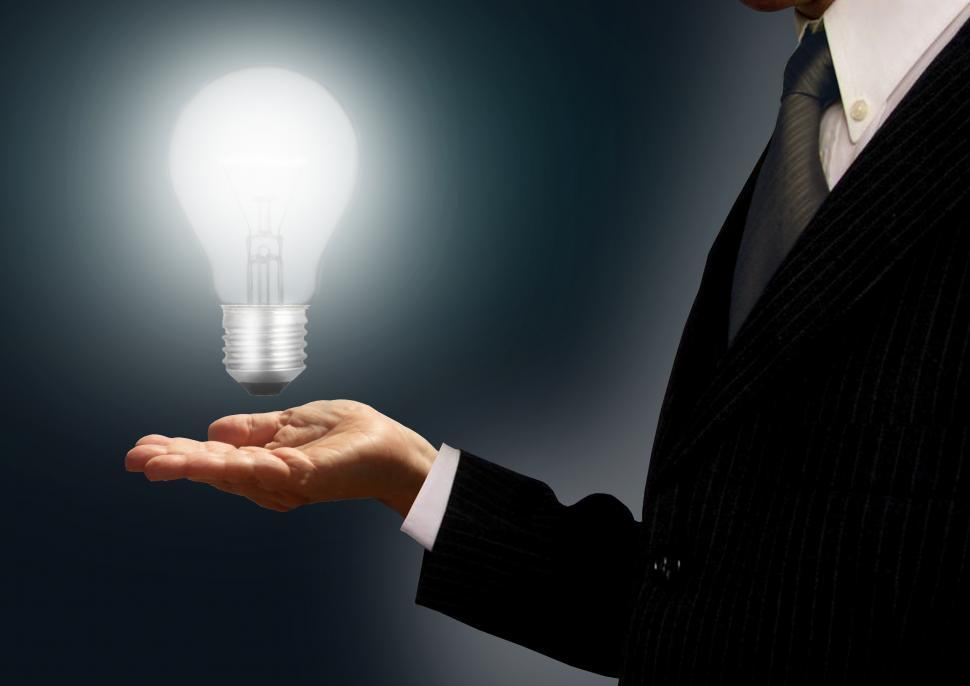 Download Free Stock Photo of Businessman holding a lightbulb - Ideas and creativity concept
