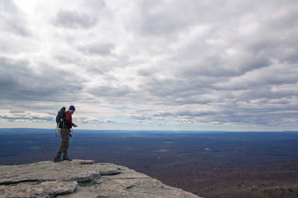 Download Free Stock HD Photo of Hiker at Sams Point Preserve Enjoying Scenic Vista Online