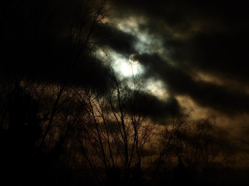 Download Free Stock HD Photo of Dark sun behind clouds Online