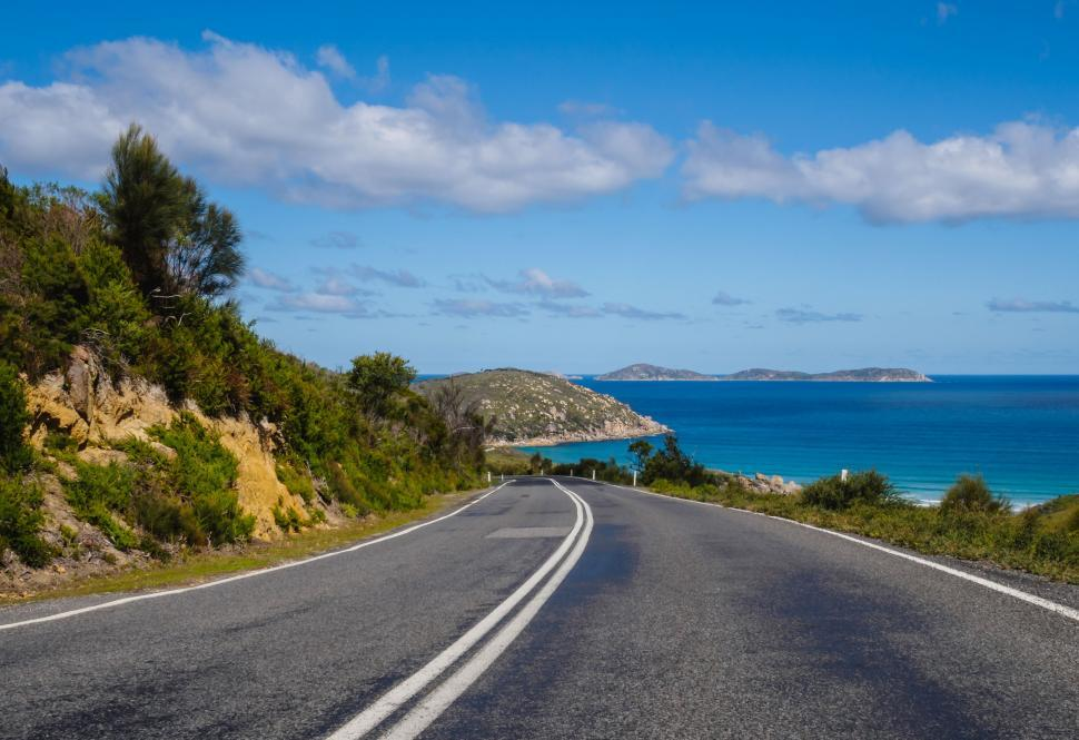 Download Free Stock Photo of asphalt road highway drive sky landscape transportation horizon travel transport speed way car motion clouds cloud freeway fast traffic scenic journey grass direction trip meadow summer route freedom countryside scenery auto automobile scene
