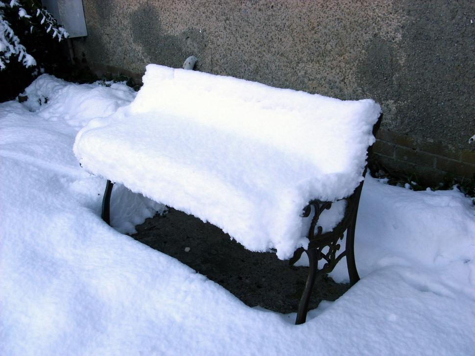 Download Free Stock Photo of Snow-covered garden bench