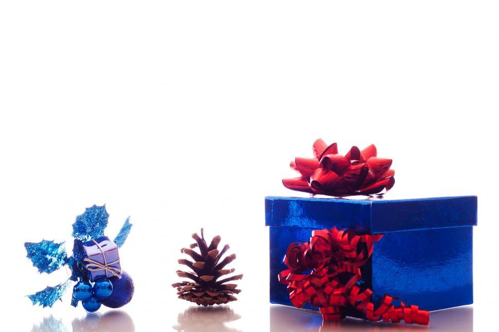 Download Free Stock HD Photo of Christmas ornaments and gift box on white Online