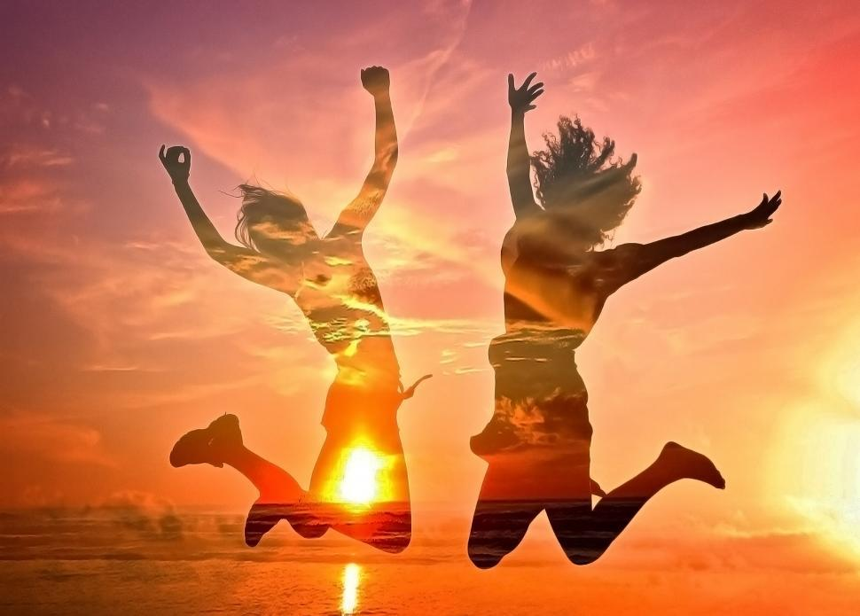 Download Free Stock Photo of Two Girls Cheering on the Beach - Double Exposure Effect