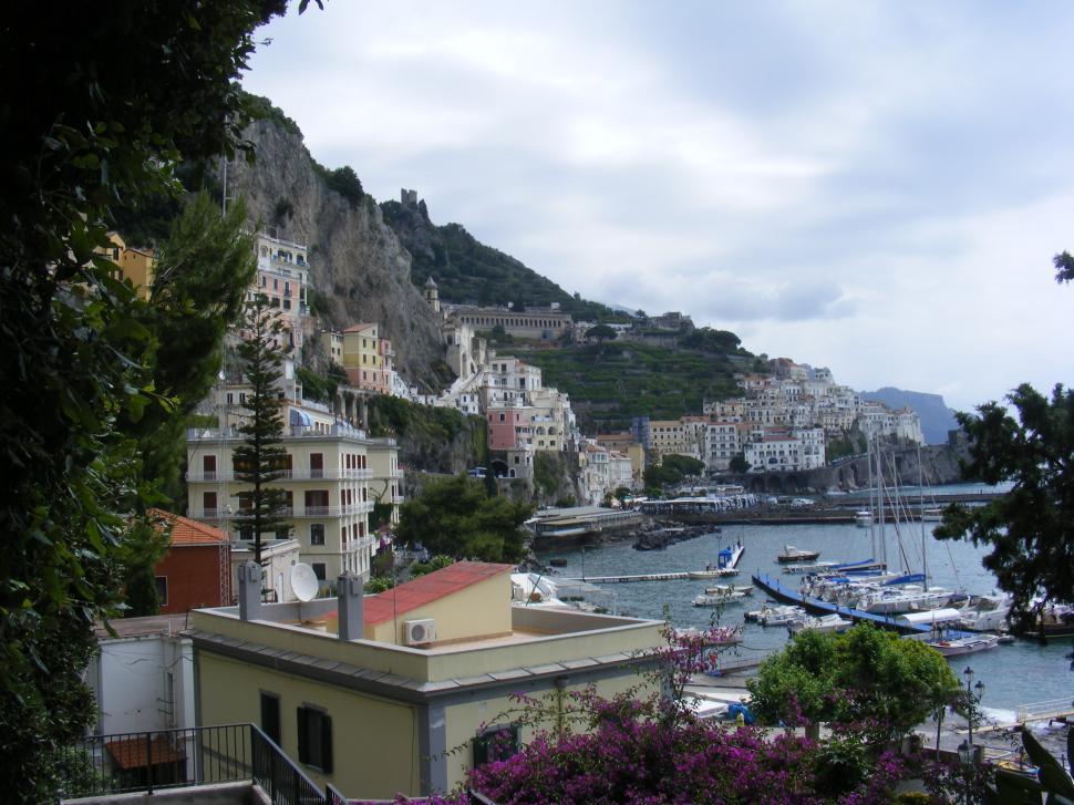 Download Free Stock HD Photo of Small sailing ships, rocky shore, Italian sea coast  Online
