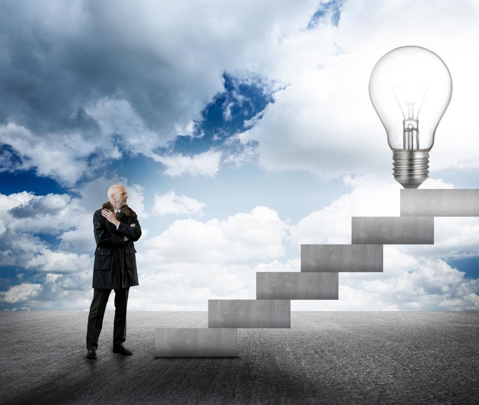 Download Free Stock Photo of Businessman facing stairs with lightbulb