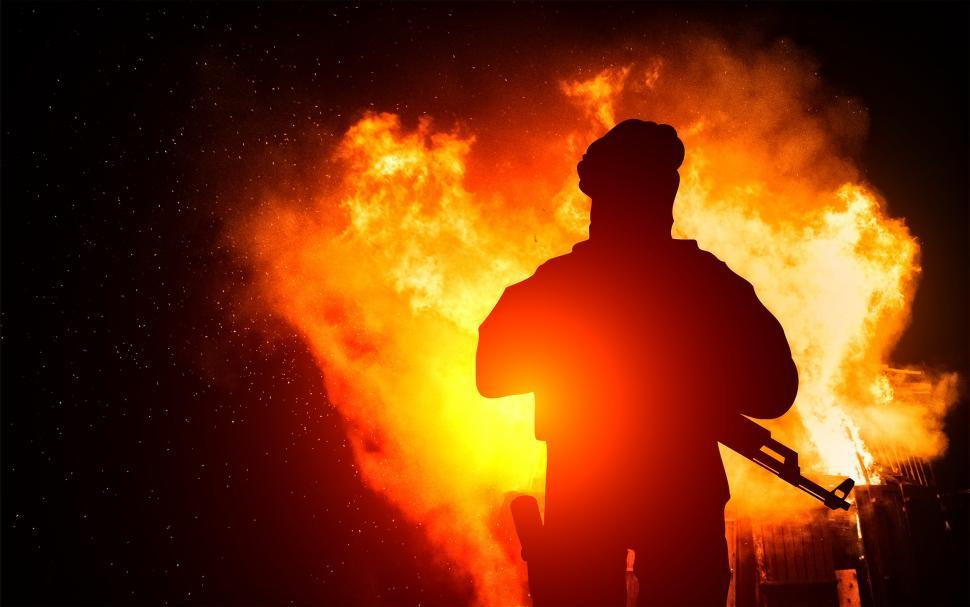 Download Free Stock HD Photo of Armed Man with Background Explosion Online