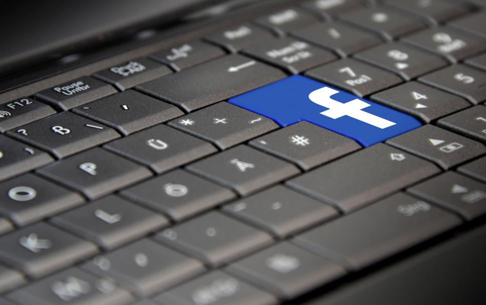 Download Free Stock HD Photo of Facebook Logo on Laptop Keyboard Online