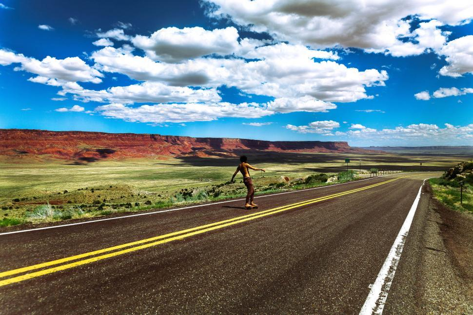 Download Free Stock Photo of Skateboarding on the open road