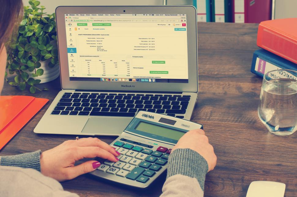 Download Free Stock Photo of Working finances on a laptop