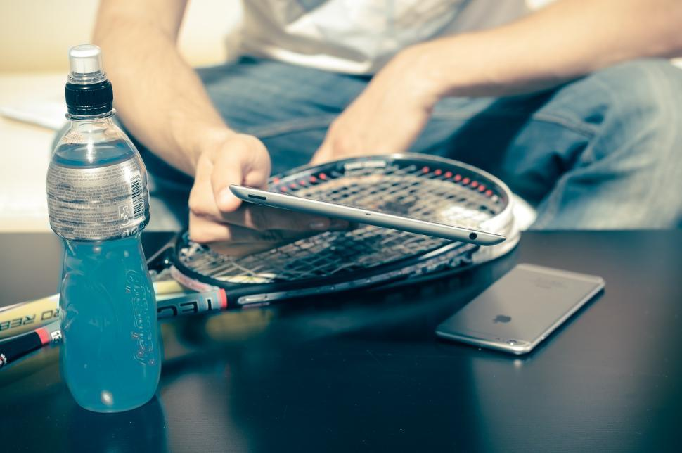 Download Free Stock Photo of Mobile device user after squash