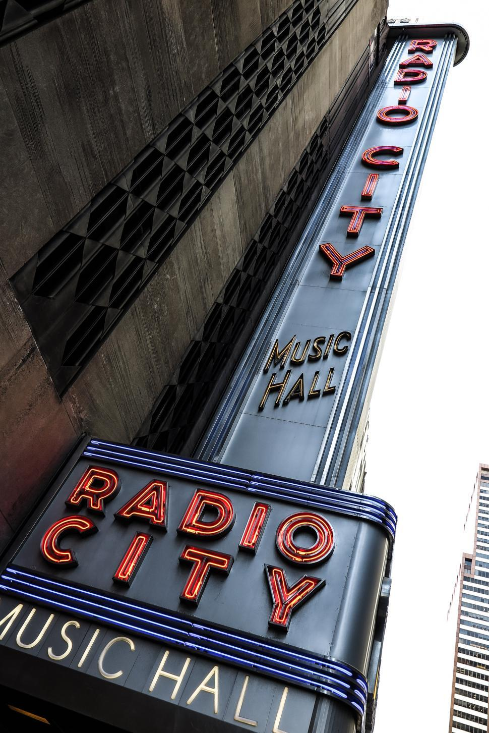 Download Free Stock HD Photo of Tall Radio City Music Hall neon sign Online