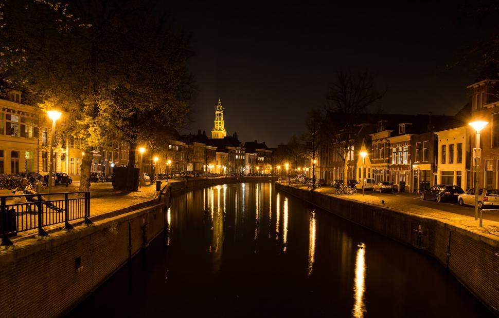 Download Free Stock Photo of city architecture building river urban cityscape waterfront tower travel water night tourism skyline sky landmark bridge palace europe buildings house town landscape scene capital reflection panorama