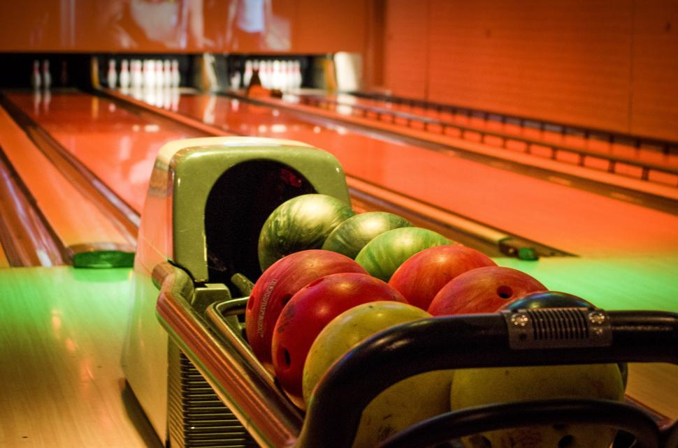 Download Free Stock HD Photo of Bowling balls in alley Online