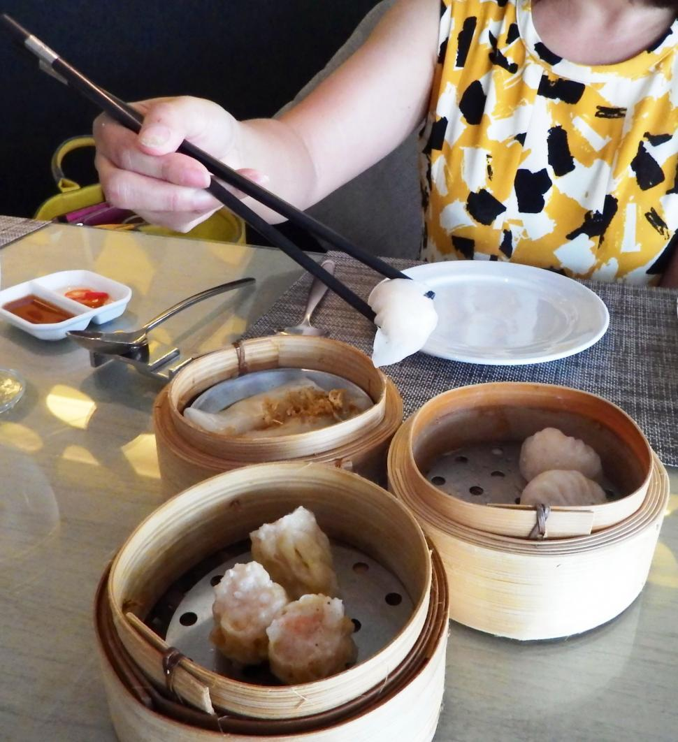 Download Free Stock Photo of Eating Dim Sum with Chopsticks