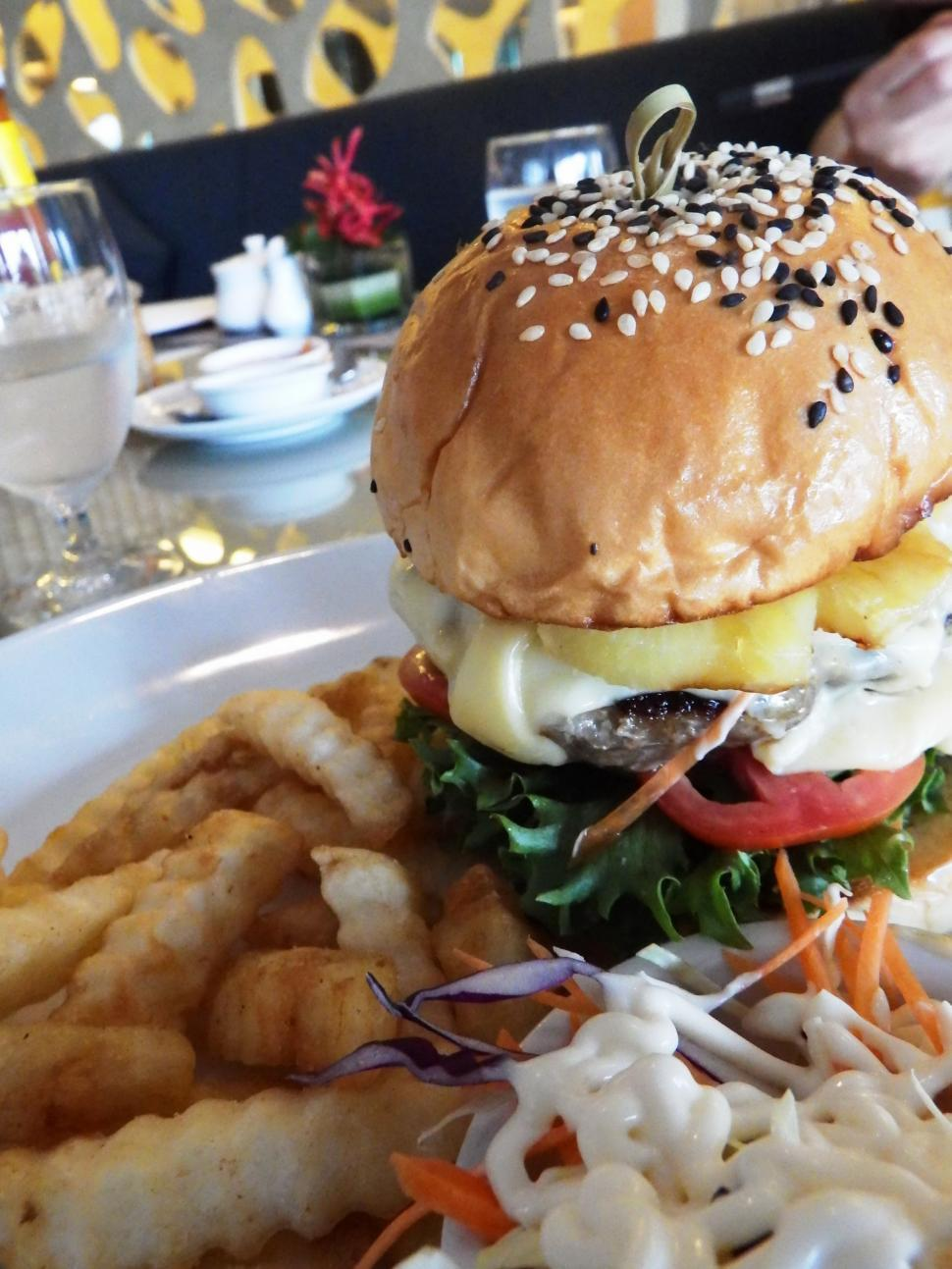 Download Free Stock HD Photo of Cheese Burger on Sesame Seed Bun and fries Online
