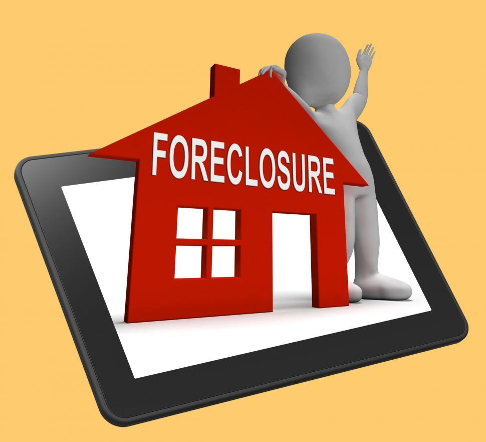 Download Free Stock HD Photo of Foreclosure House Tablet Shows Repossession And Sale By Lender Online