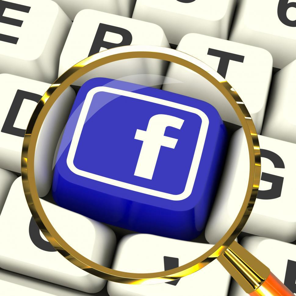 Download Free Stock HD Photo of Facebook Key Magnified Means Connect To Face Book Online
