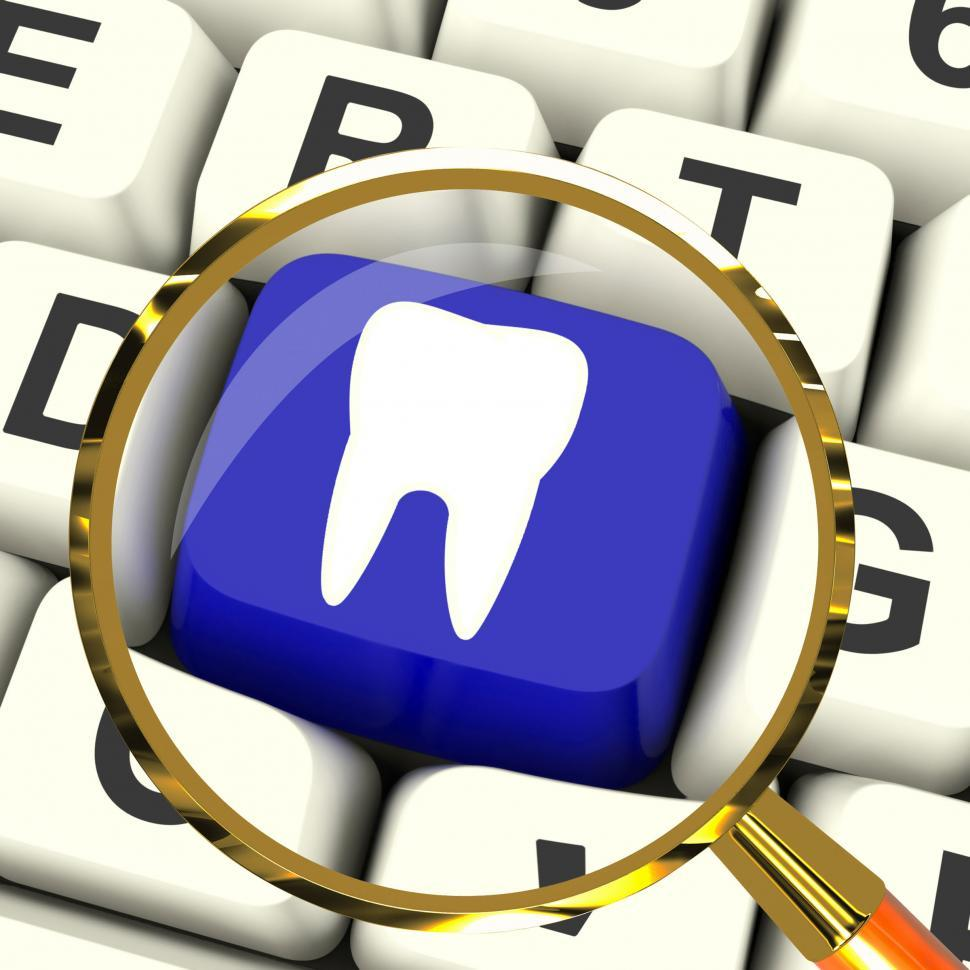 Download Free Stock HD Photo of Tooth Key Magnified Means Dental Appointment Or Teeth Online