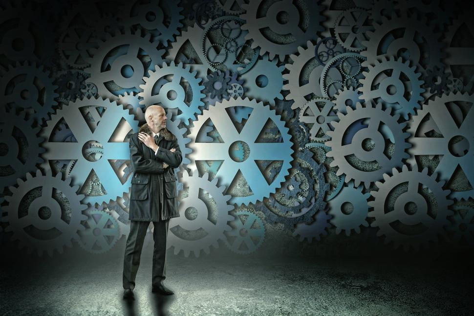 Download Free Stock Photo of Businessman and Cogwheels