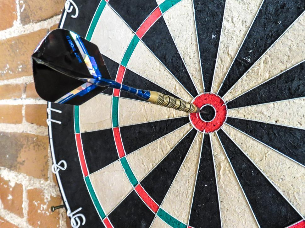 Download Free Stock HD Photo of Dart in a dartboard bullseye Online