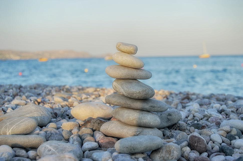 Download Free Stock Photo of Pyramid of stone on the stone beach symbolizing zen
